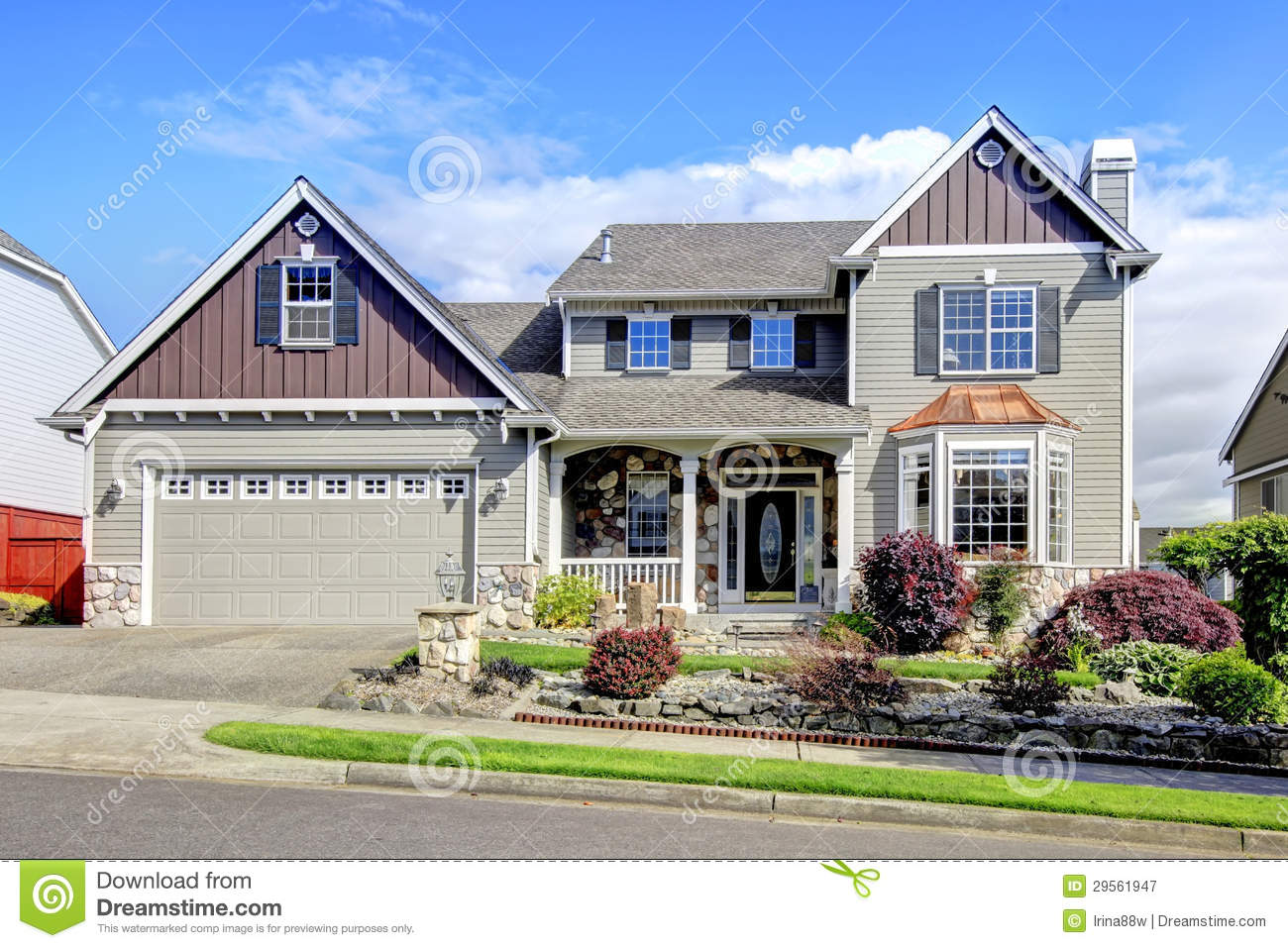 Beautiful grey new classic home exterior with natural for Classic home exteriors