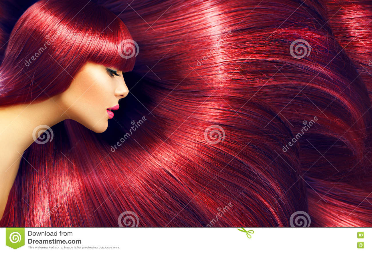 Beautiful hair. Beauty brunette woman with long straight red hair