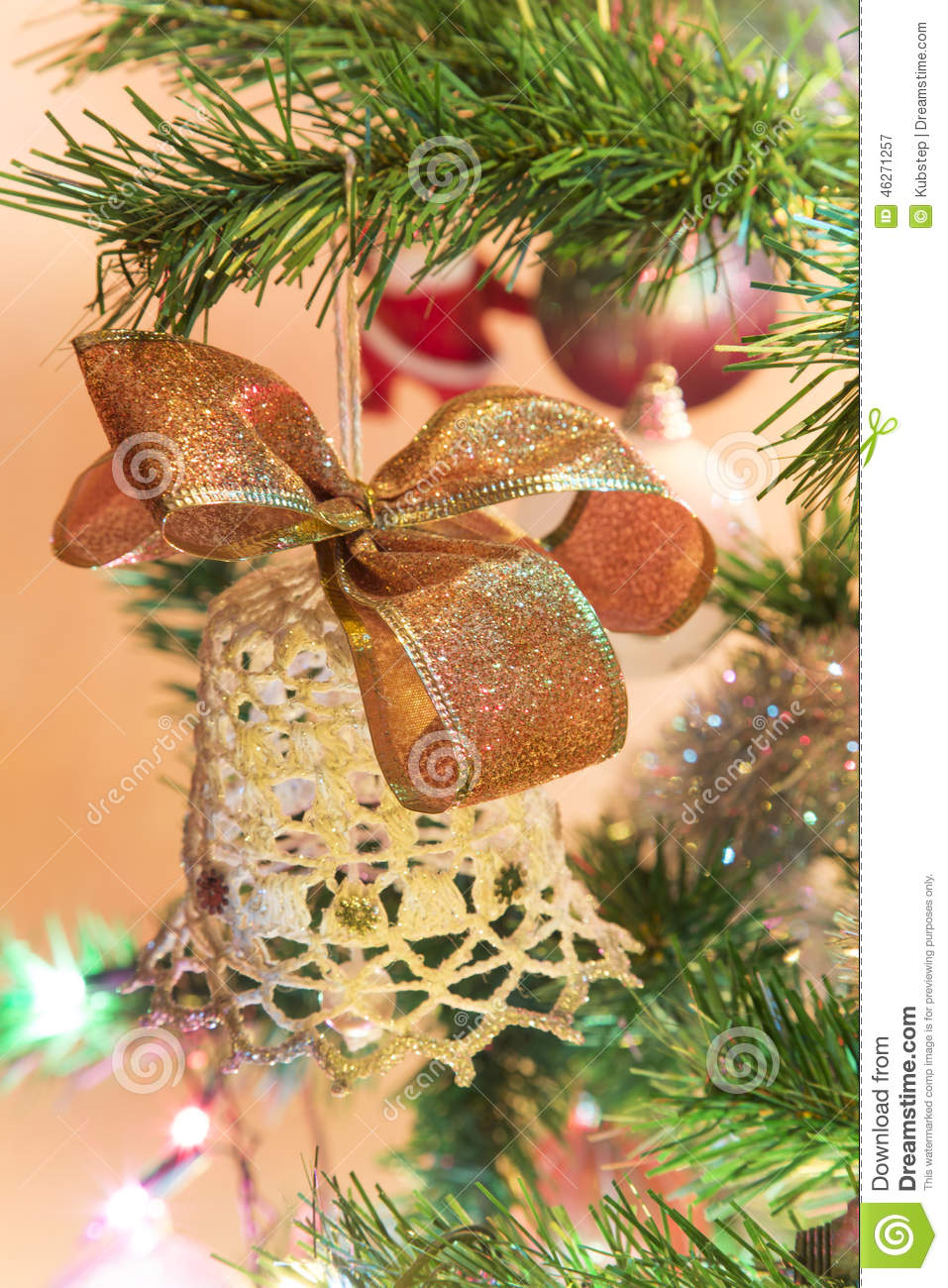Beautiful hand made bell with bow on Christmas Tree