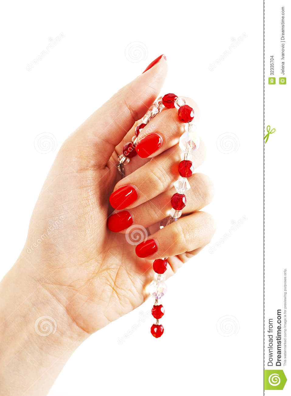 Beautiful Hand Of A Woman With Red Manicure Holding Red Pearl Necklace