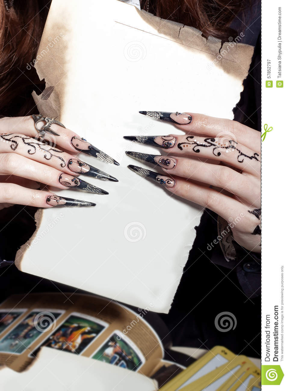 Beautiful Hands With Long Acrylic Witch Black Nails Holding A White Sheet In The Hands Of Stock