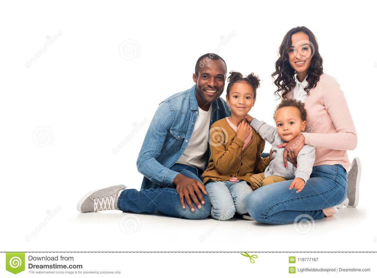 beautiful happy african american family with two kids smiling at camera