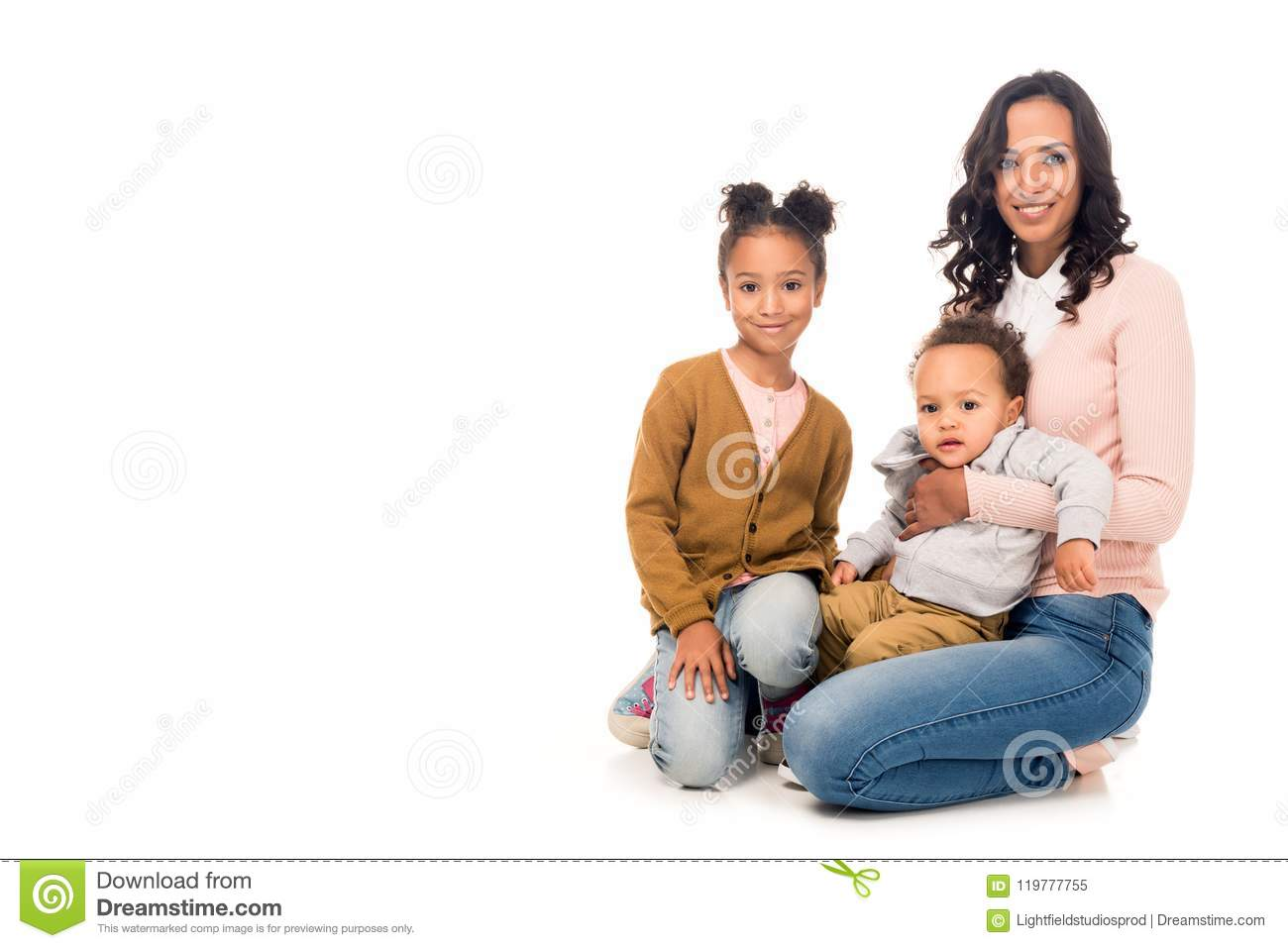 beautiful happy african american mother with adorable little kids smiling at camera