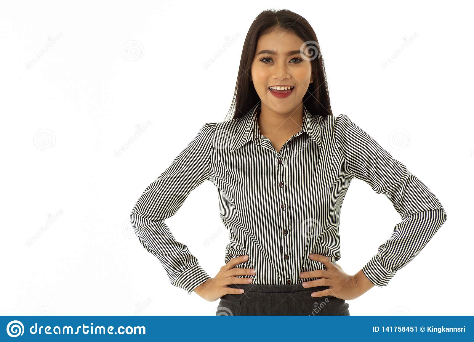 Beautiful happy asian young lady stood with arms akimbo