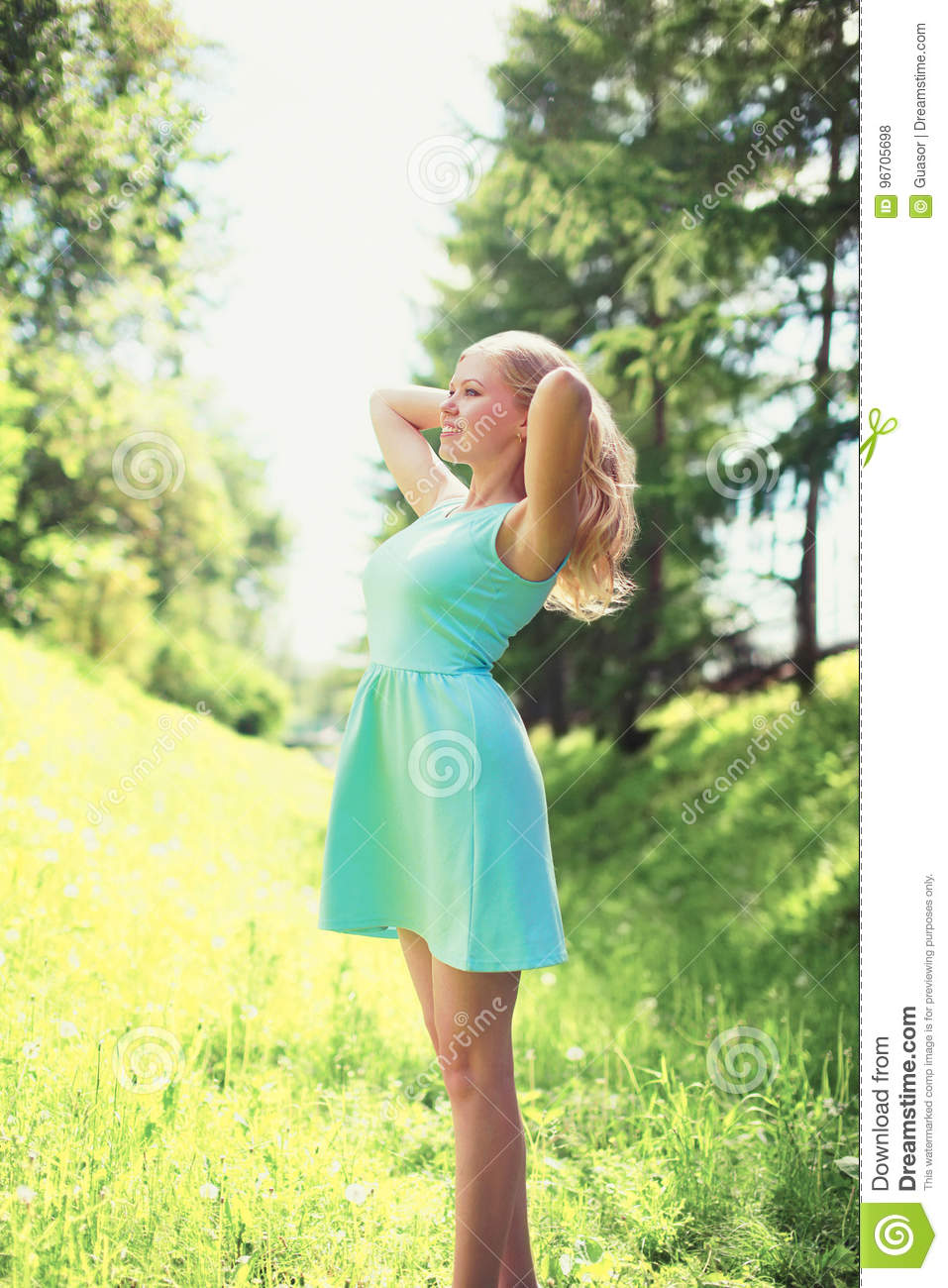 Beautiful happy blonde young woman in dress