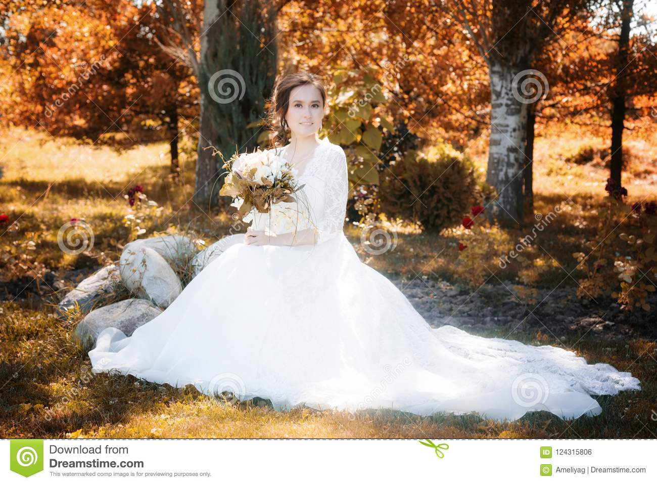 Beautiful happy bride with bouqet