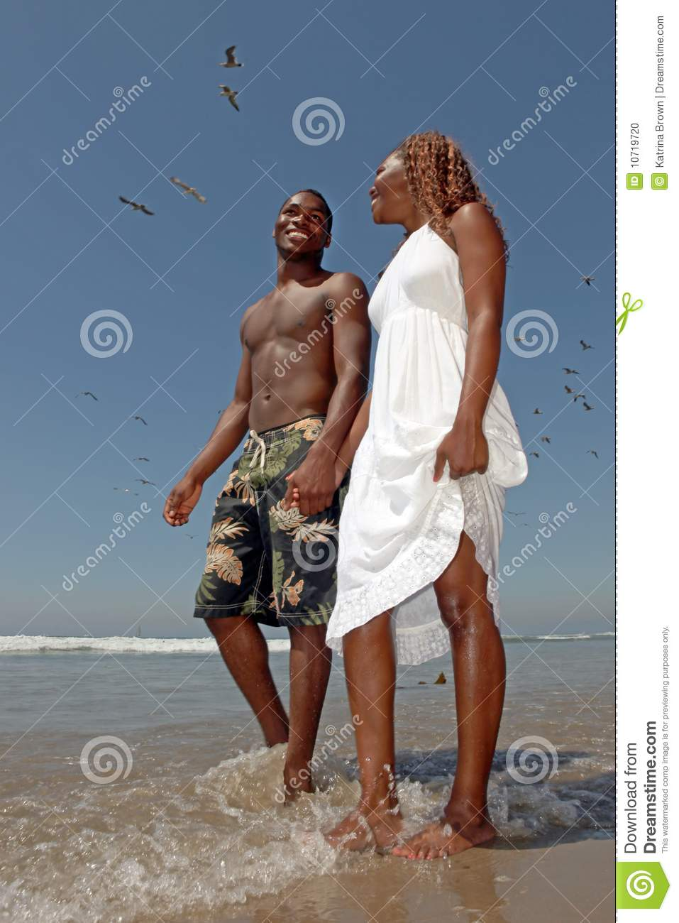 Beautiful Happy Couple Walking Along the Beach