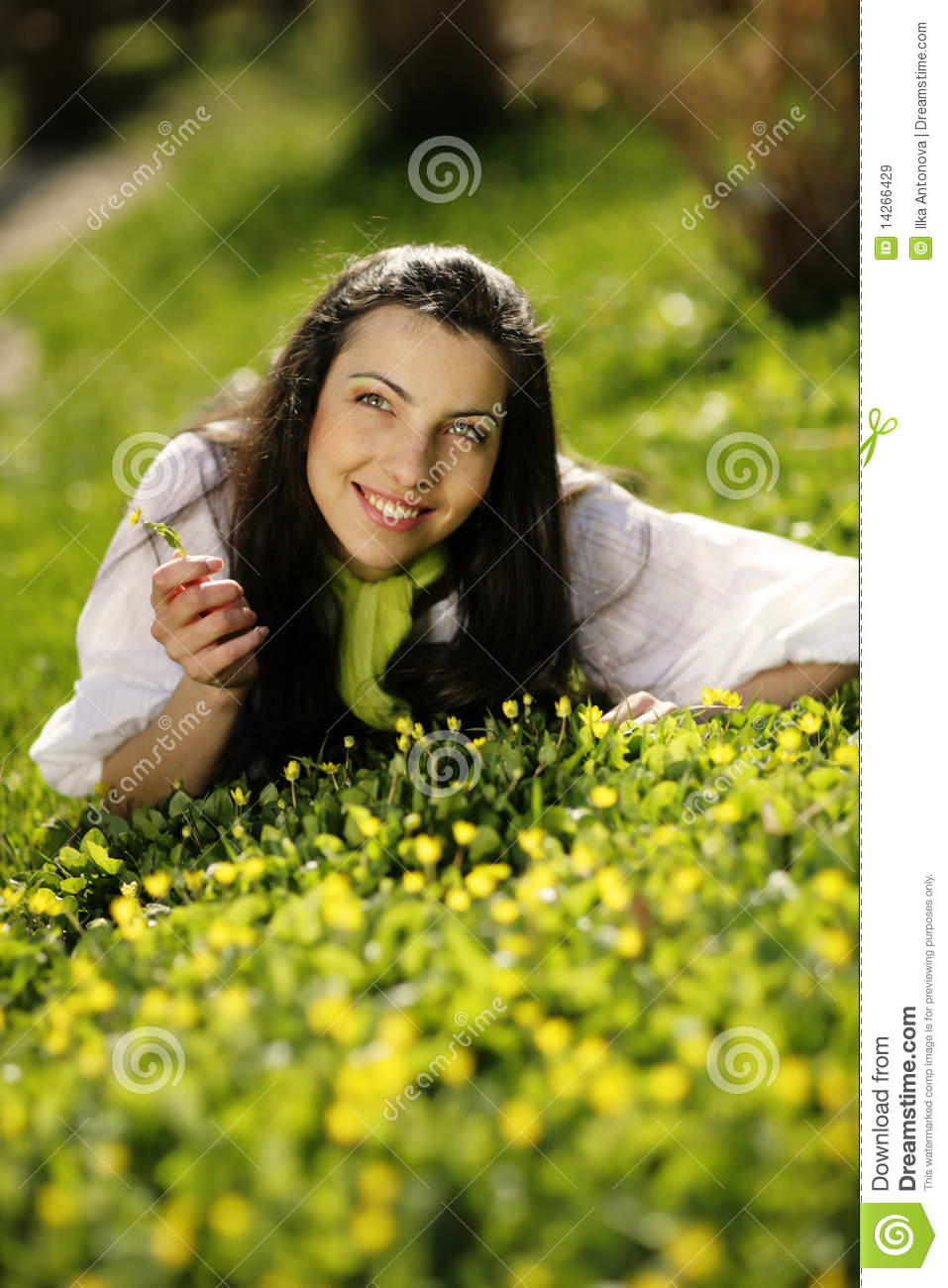 Beautiful happy girl lying in the grass