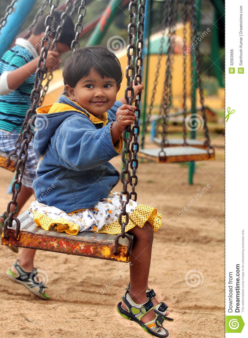 Beautiful & Happy Indian Girl(child) Playing On A Swing In ...