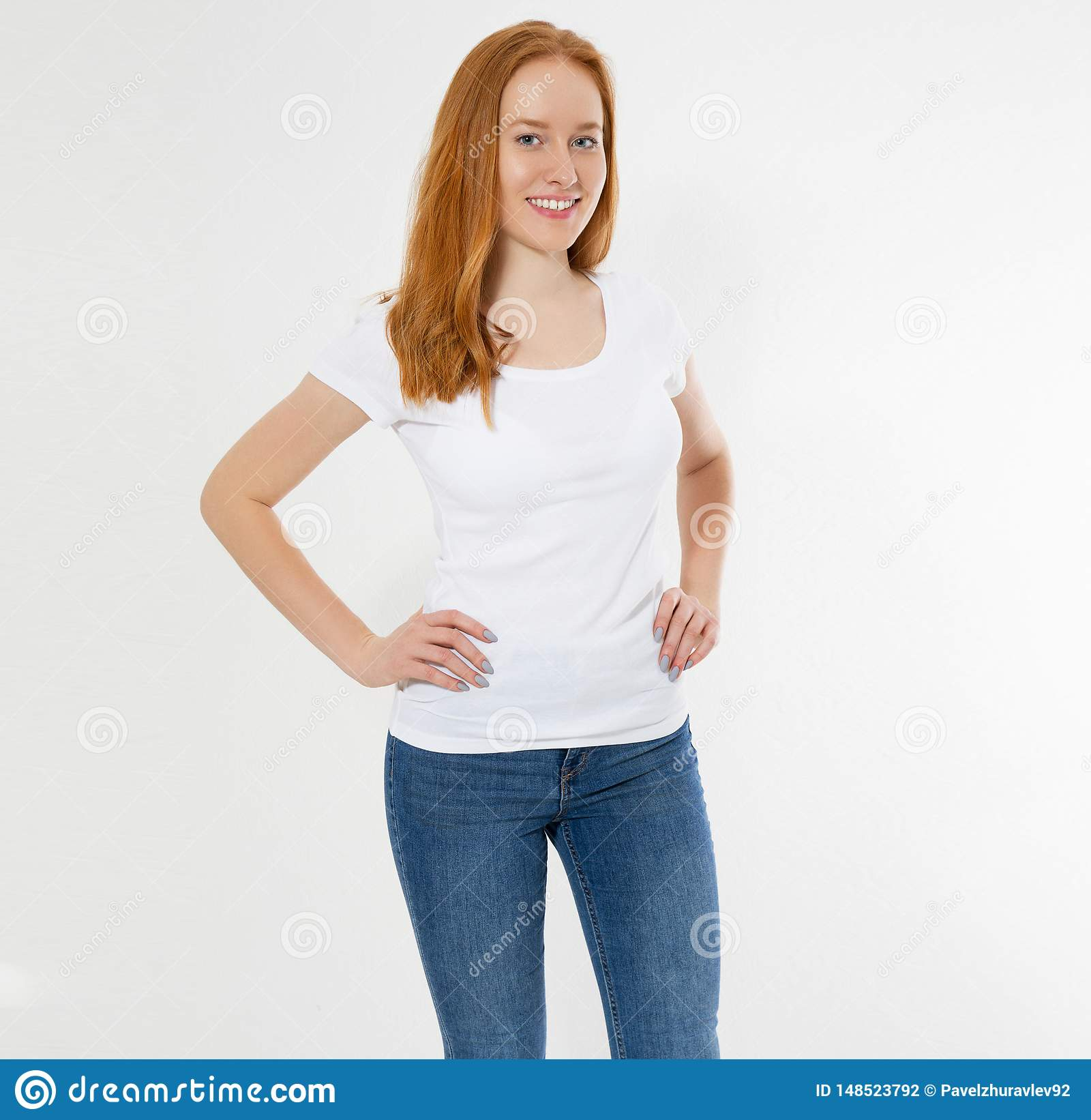 Beautiful happy red hair girl in white t-shirt isolated. Pretty smile red head woman in tshirt mock up, blank