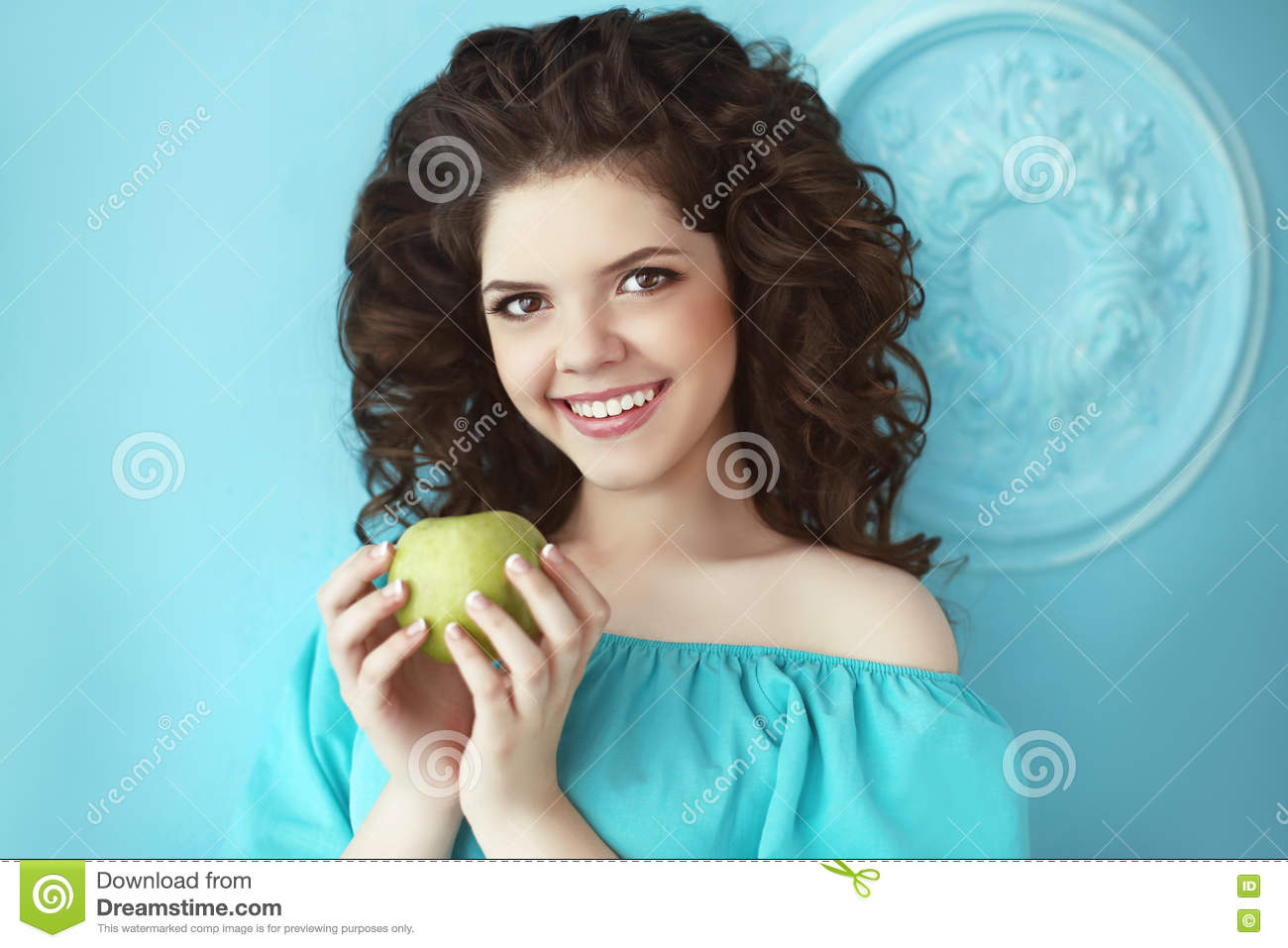 Beautiful Happy Teen Smiling Girl Holding Green Apple Before The