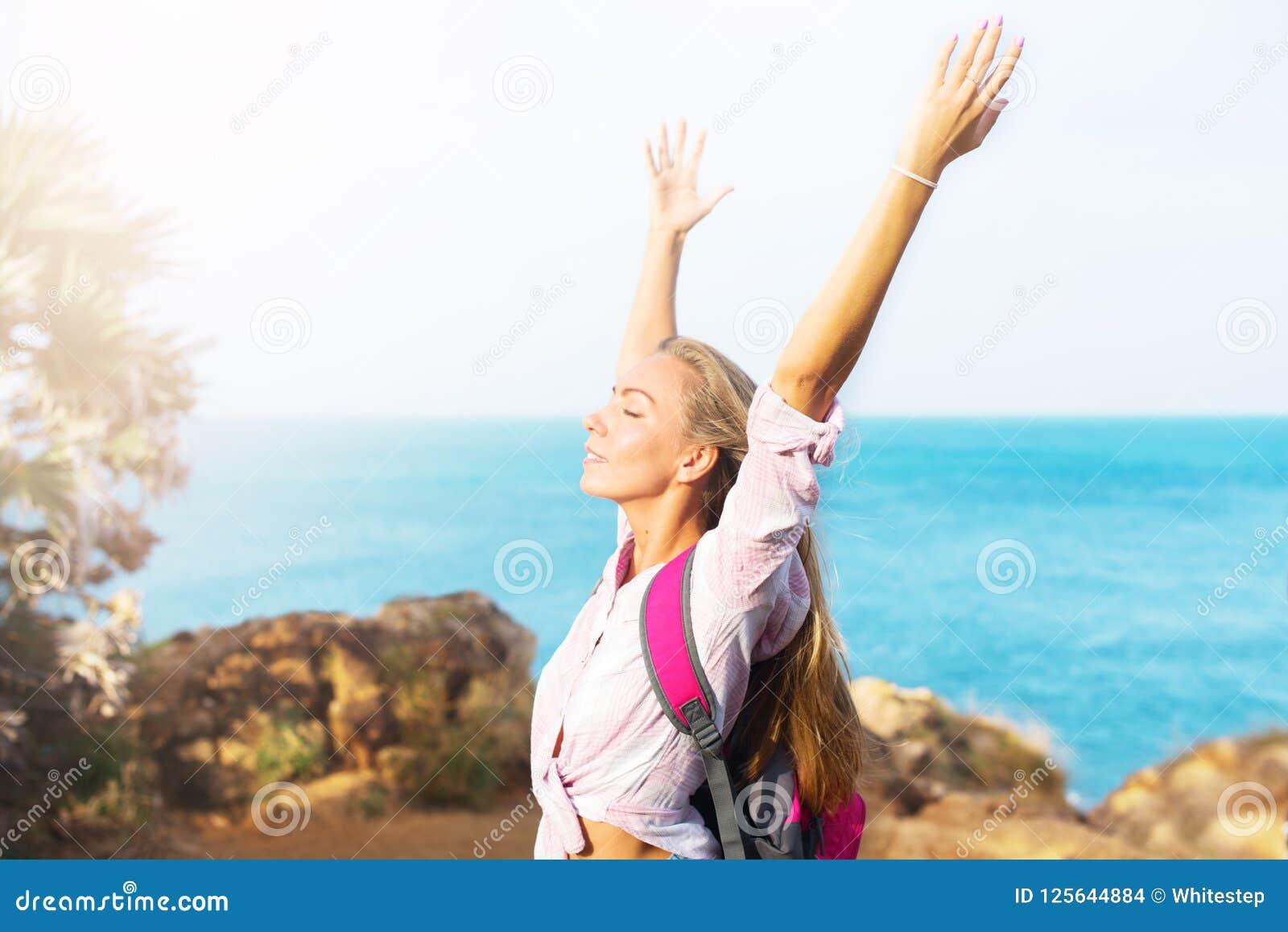 Beautiful happy travelling girl enjoying sun