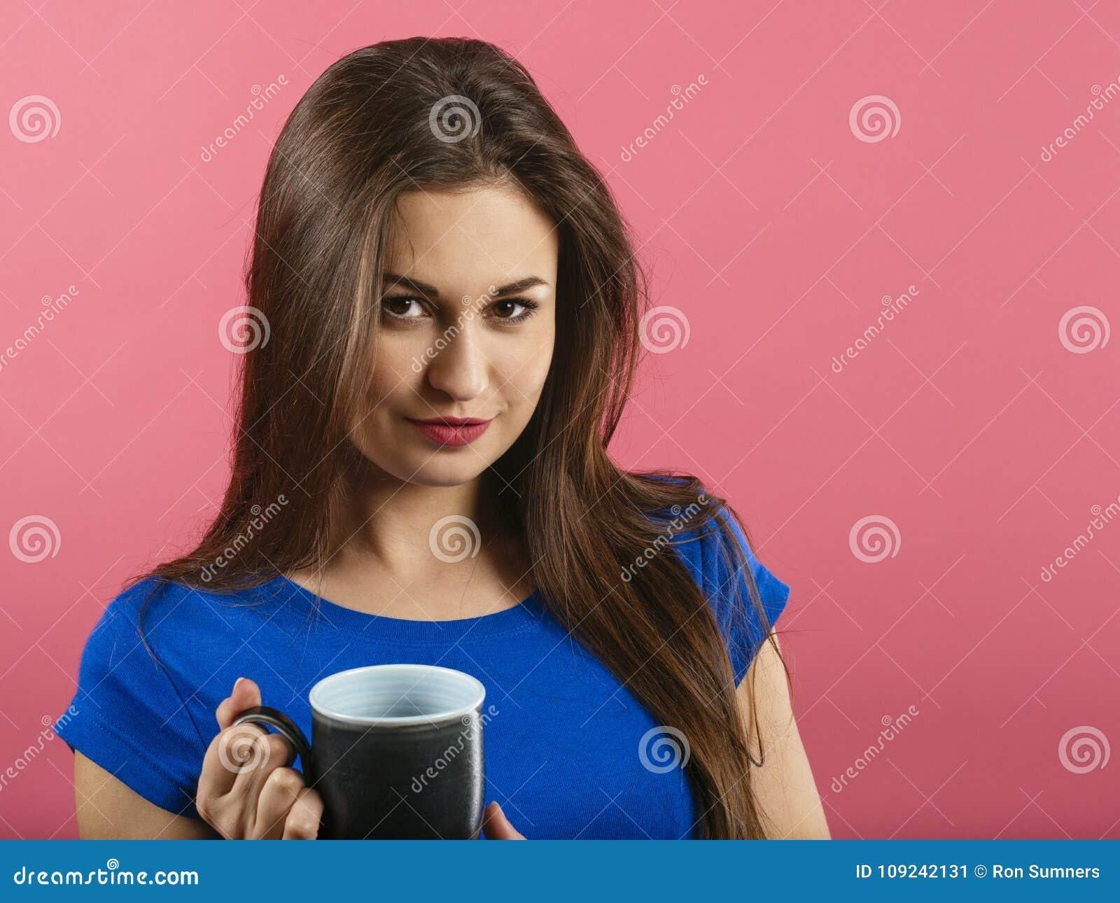 Beautiful happy woman drinking coffee