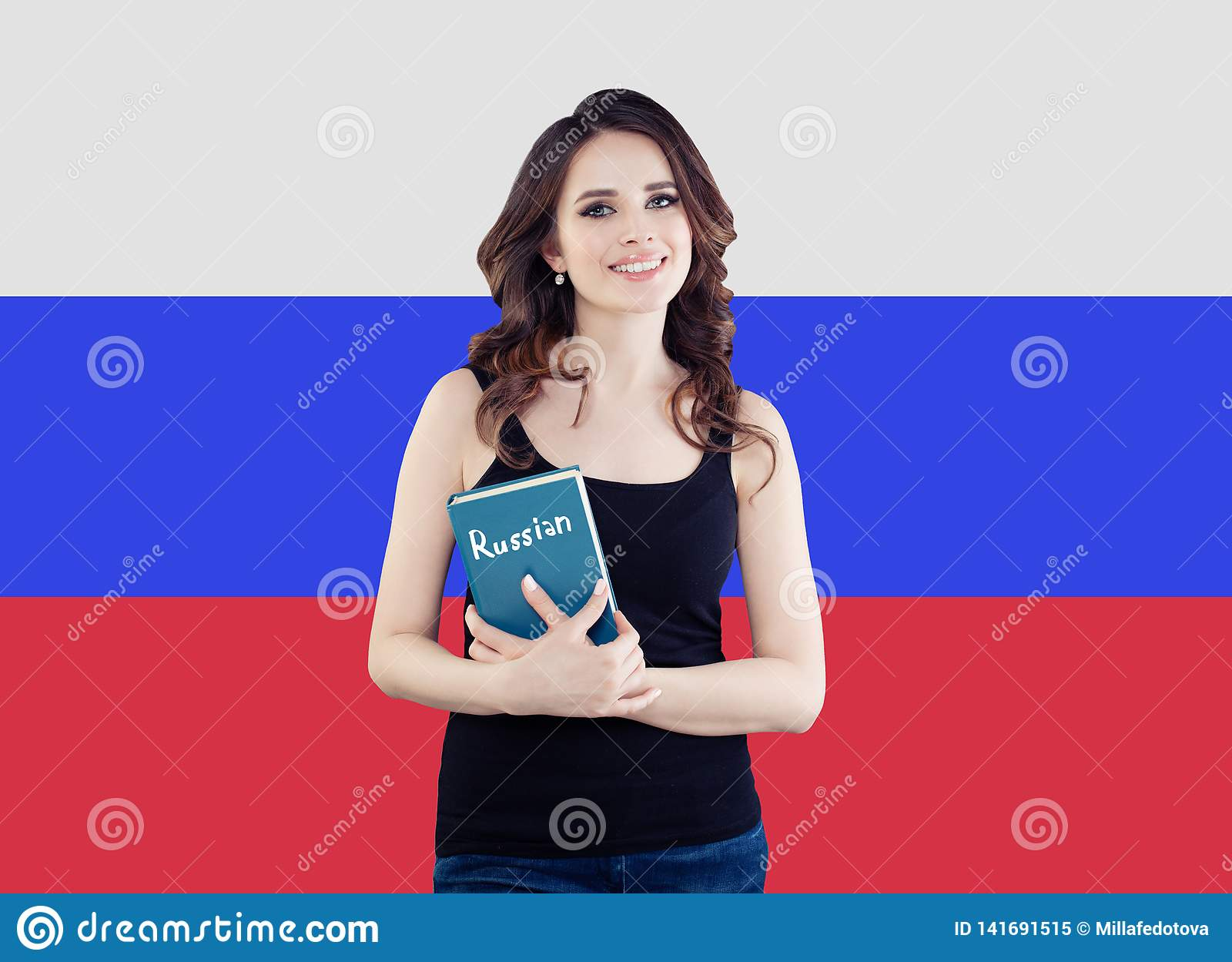 Beautiful happy woman student with textbook on the Russian Federation flag background. Learn russian language