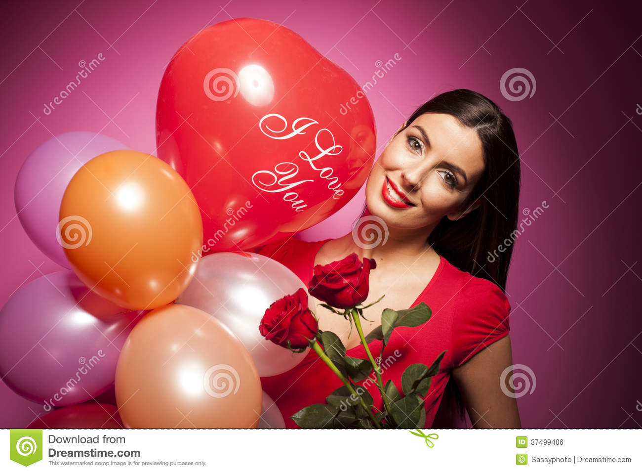 Beautiful happy woman with valentines day balloon on pink
