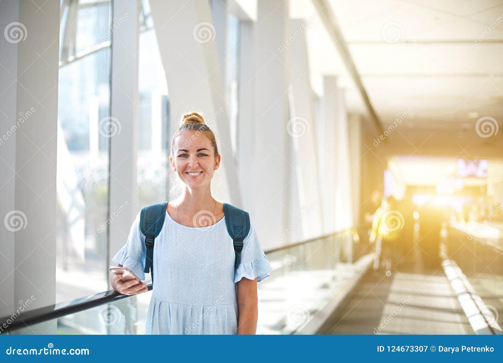 Beautiful young woman traveling in metro