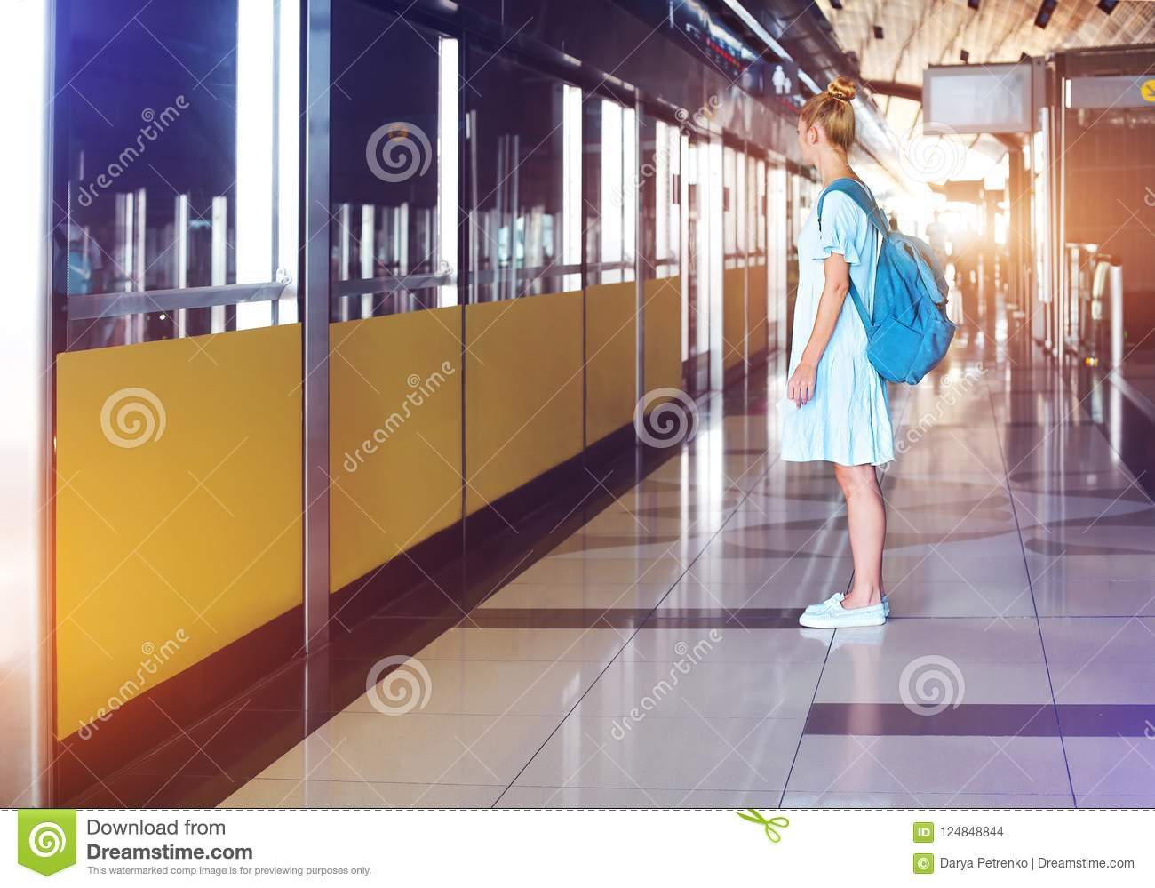 Happy young woman traveling in metro
