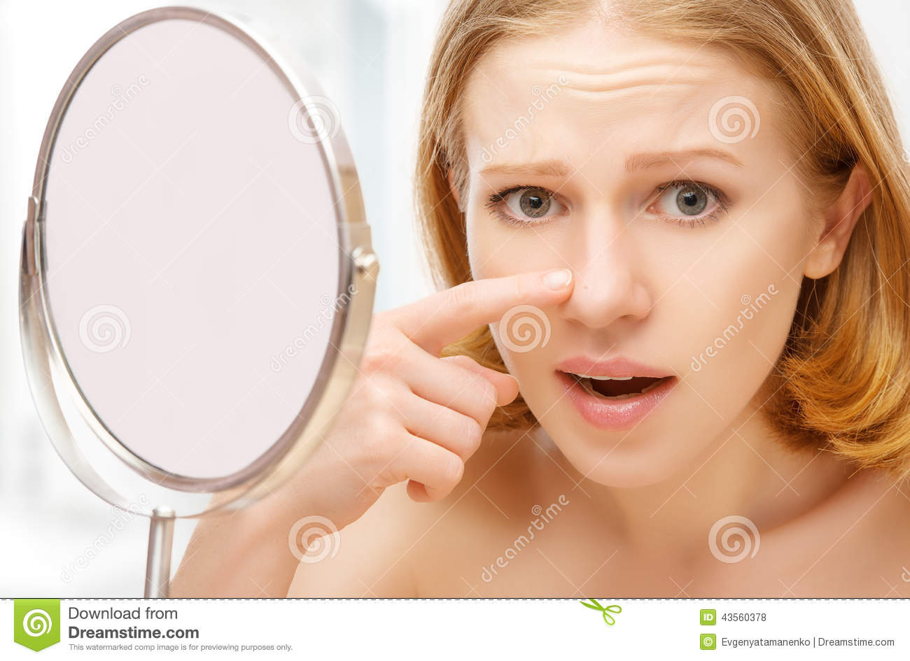 beautiful-healthy-woman-frightened-saw-mirror-acne-wrinkles-young-43560378.jpg