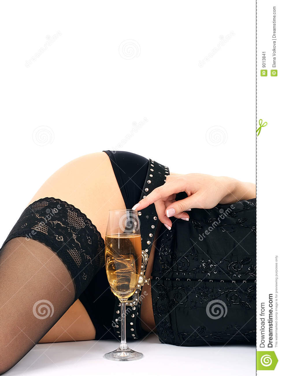 Beautiful hips and champagne glass