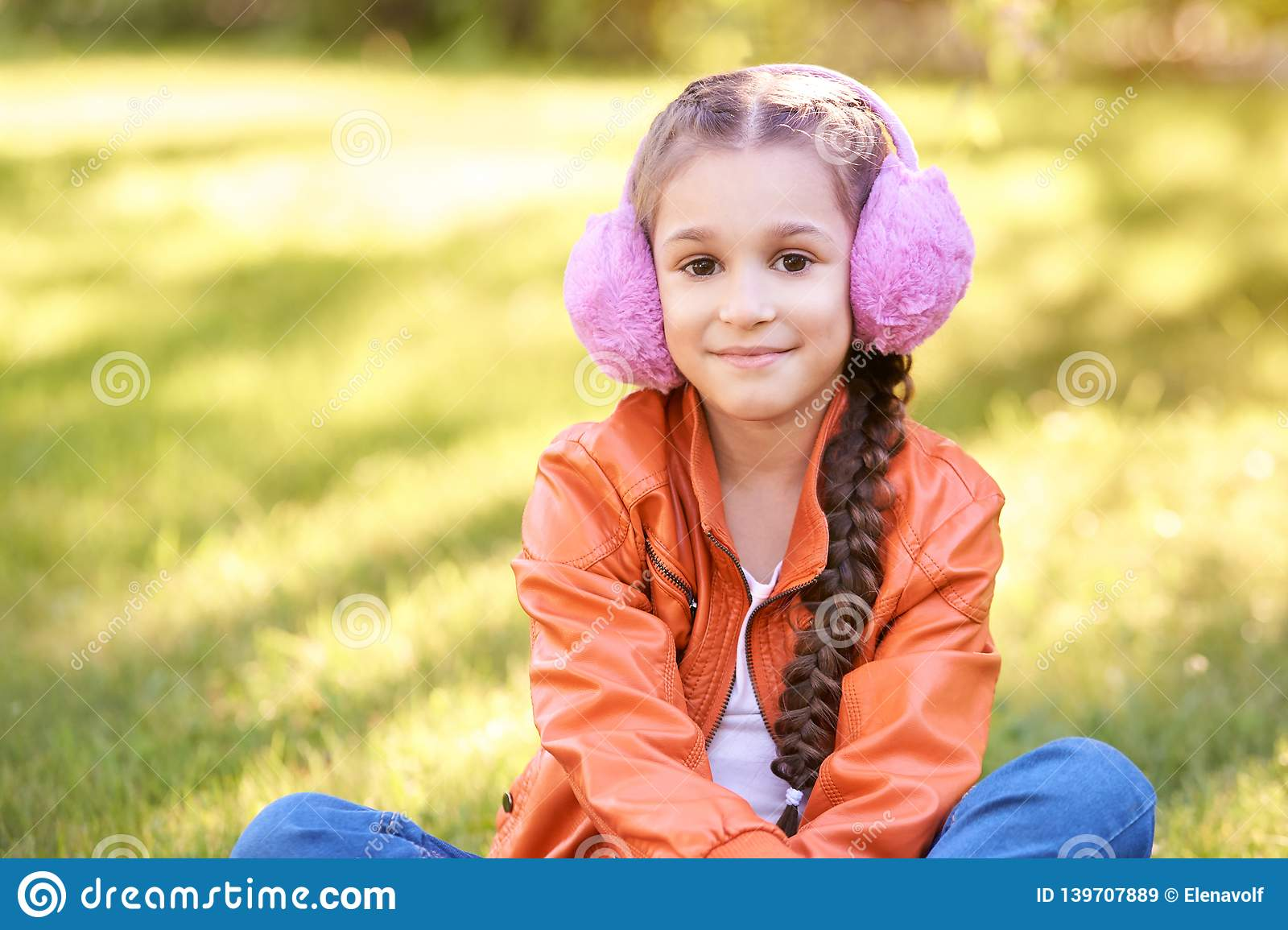 Beautiful hipster Child sitting outside. good bright baby