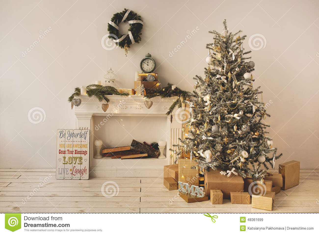 Beautiful holiday decorated room with Christmas tree with presents under it