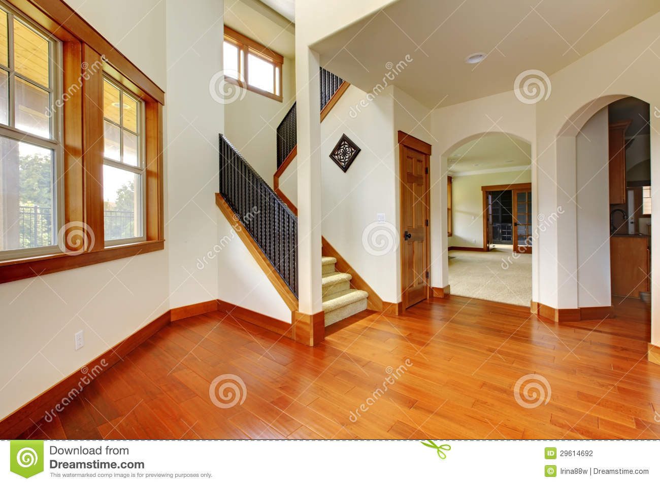 Beautiful home entrance with wood floor new luxury home for Interieur maison ossature bois