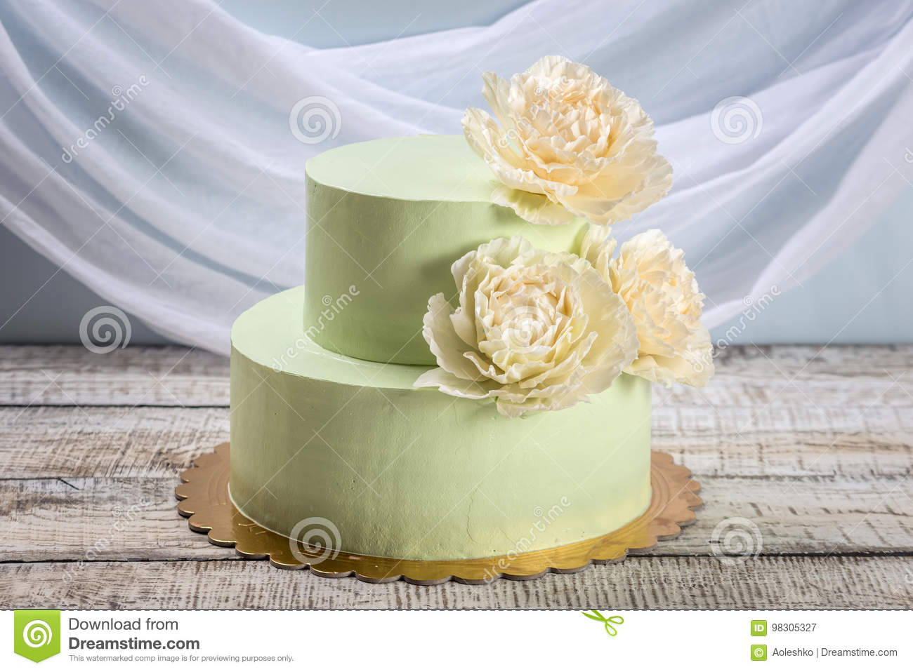 Beautiful Home Made Wedding Two-tiered Cake Decorated With Beige ...