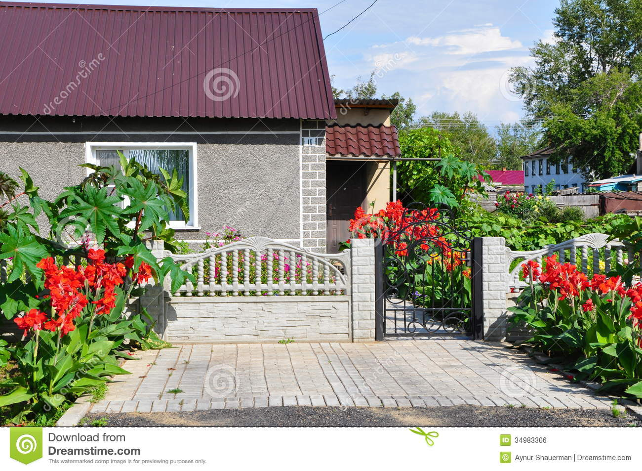 Beautiful home in the summer decorated with red flowers for Fresh air garden designs