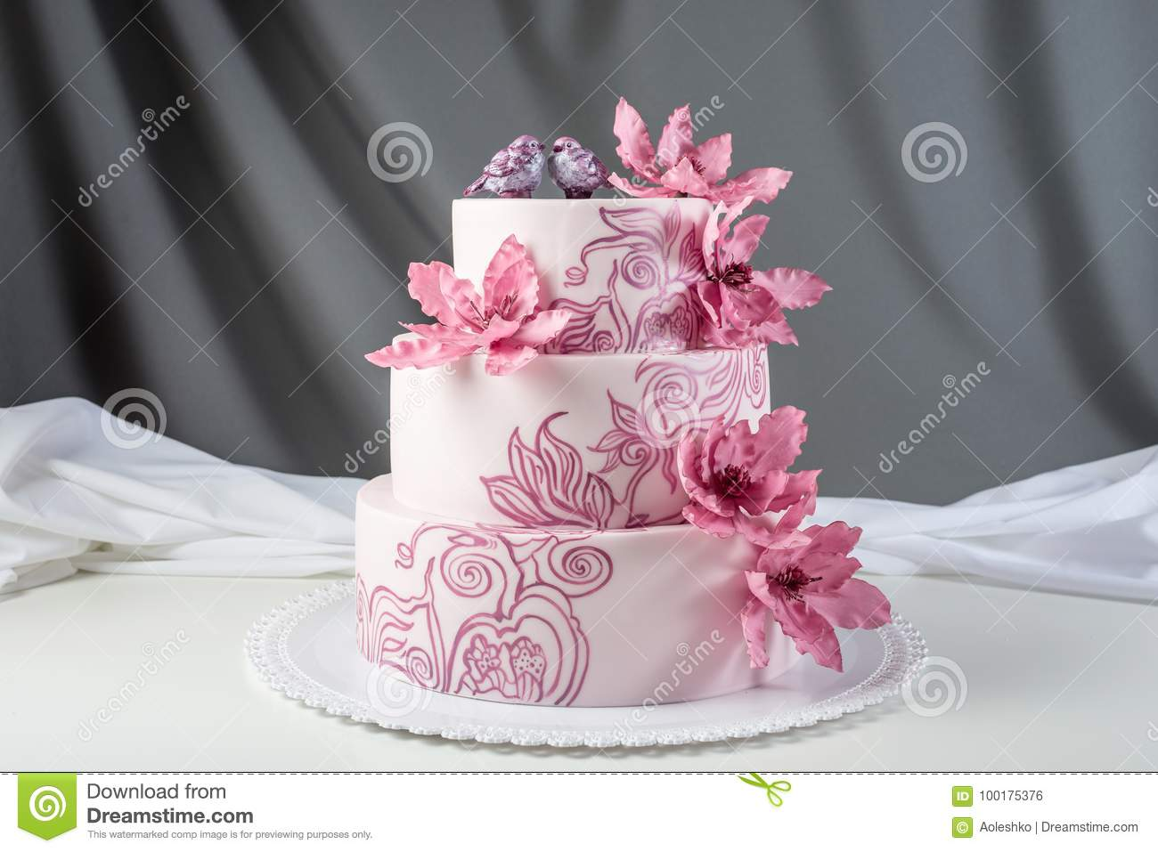 A Beautiful Home Wedding Three-tiered Cake Decorated With Pink ...