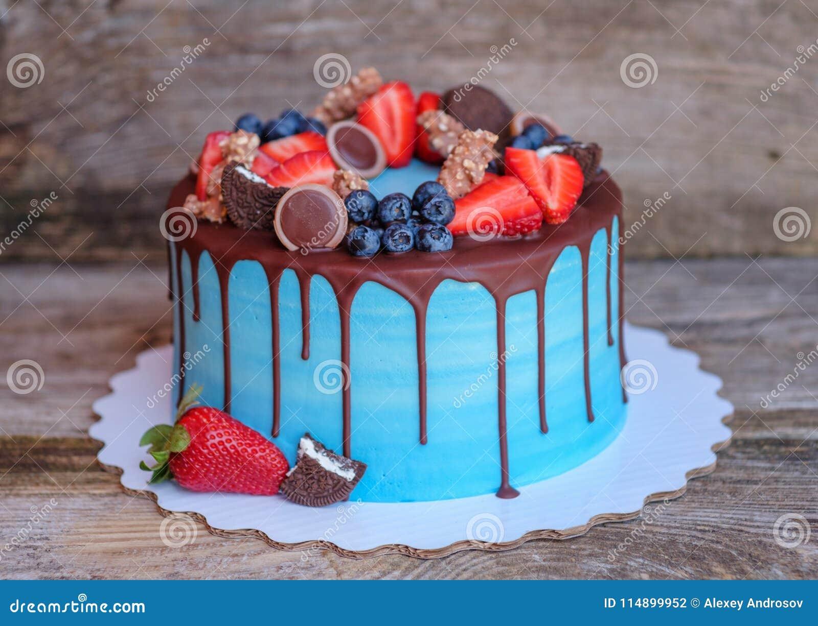 Beautiful Homemade Cake With Blue Cream And Chocolate Glaze