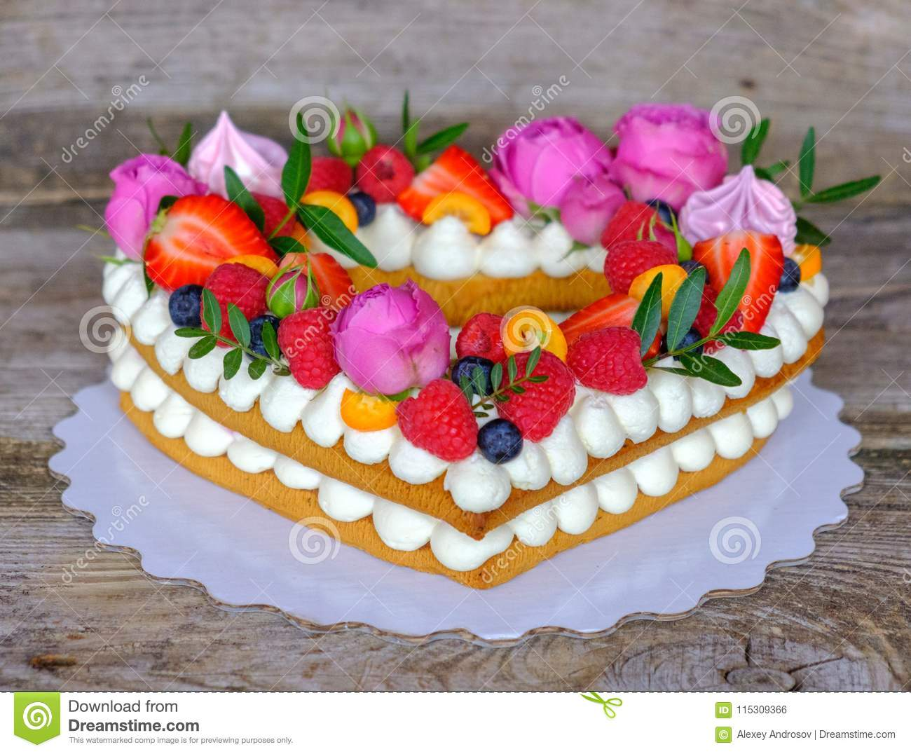 Home made heart shaped wedding cake stock photo image of biscuit beautiful homemade wedding cake in the shape of a heart decorated with flowers and berries izmirmasajfo