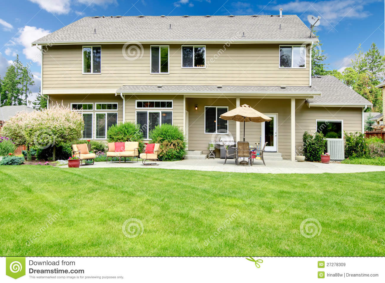 Beautiful House With Backyard Sitting Area Stock Image