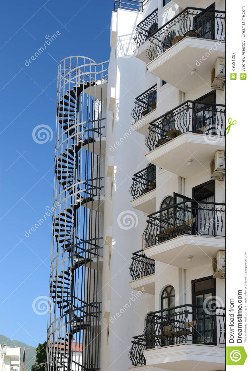 Beautiful house with balconies and fire escape stock photo - Beautiful houses with balcony ...