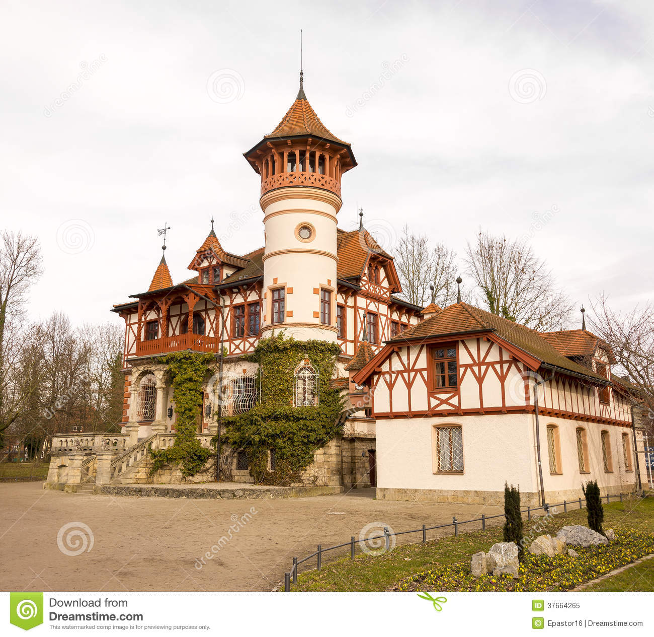 Beautiful House With A Big Tower By The Lake Royalty Free