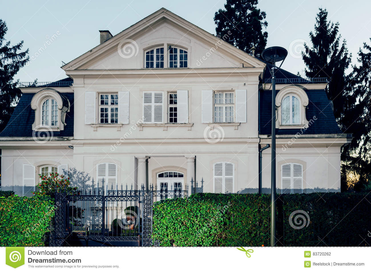 Beautiful House At Dusk In Classic French Architecture Stock Photo