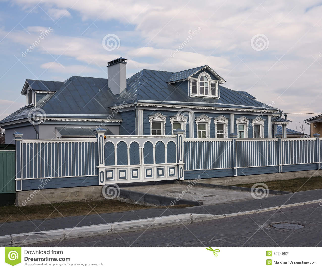 The beautiful house and wooden gates stock photo image