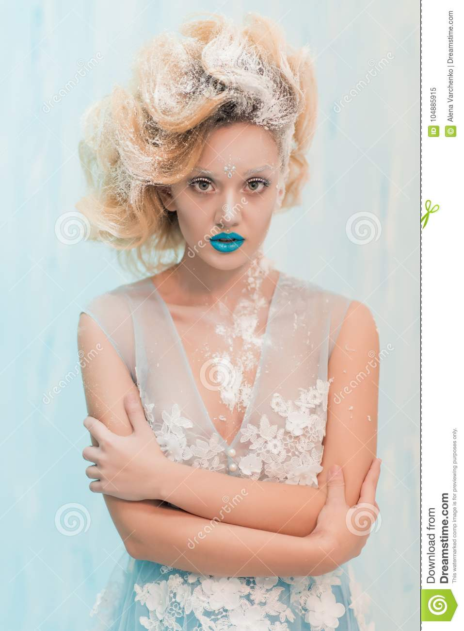 Beautiful Ice Queen With Blue Lips And Hairstyle With Snow In Hair