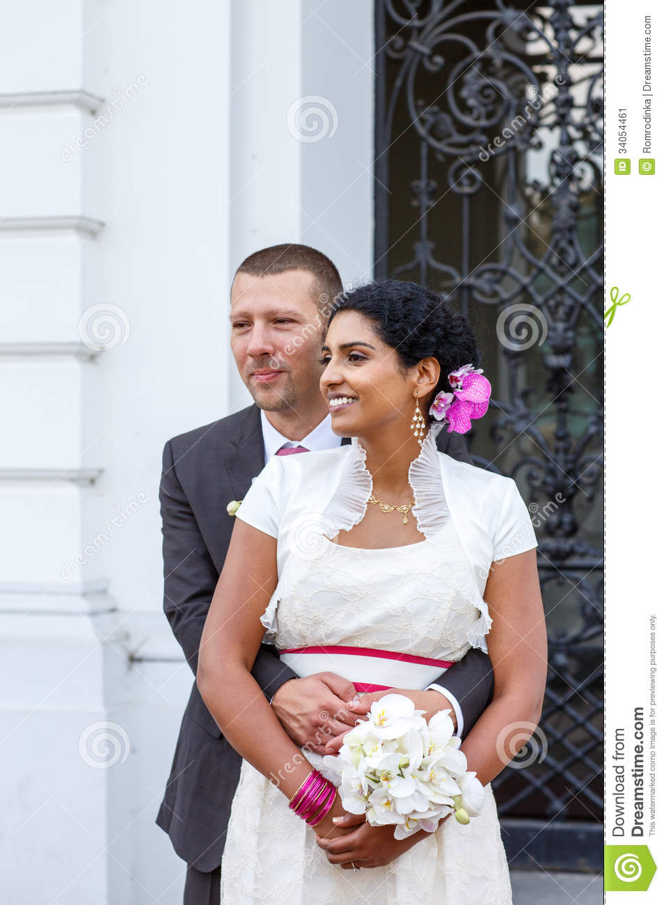 Beautiful indian bride and caucasian groom after wedding for Dress after wedding ceremony