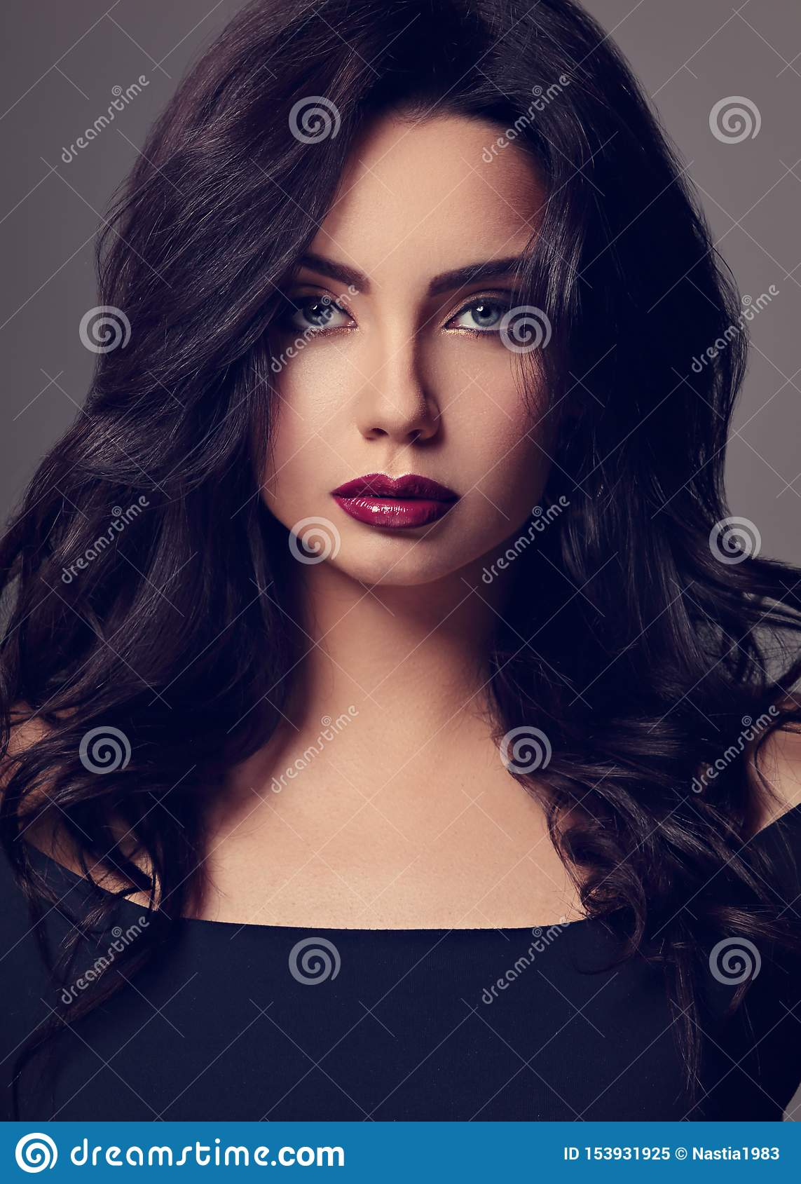 Beautiful Indian Bright Makeup Woman With Long Black Curly