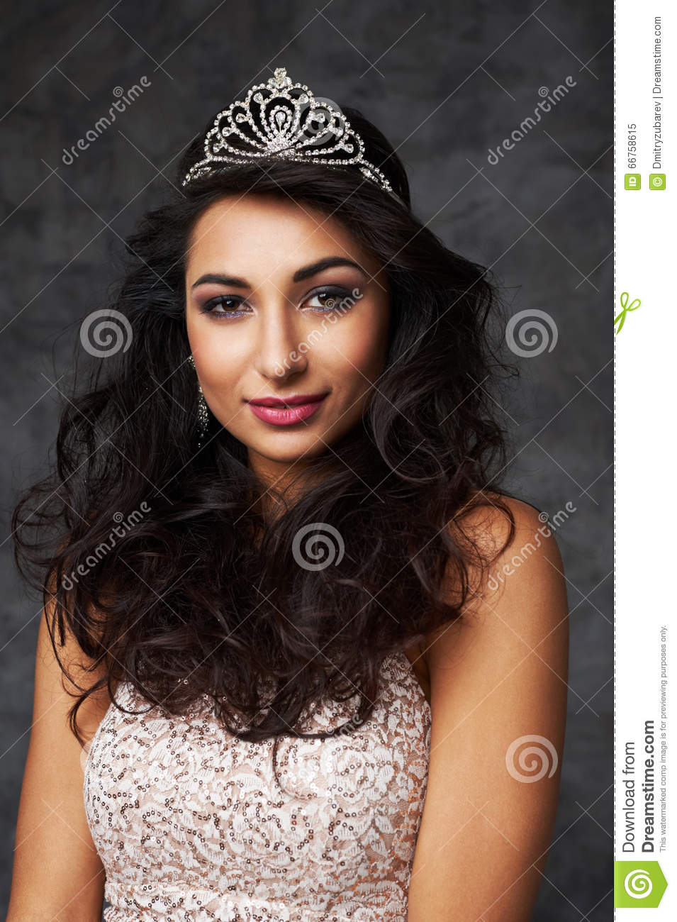 beautiful indian lady in fitting dress and diadem stock