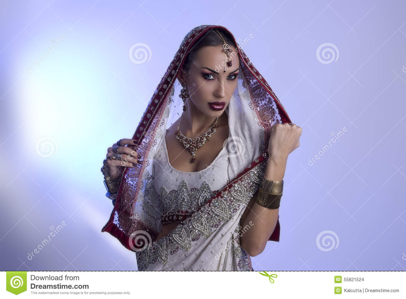 67eaa53fa0 Beautiful Young Indian Woman in Traditional Clothing with Bridal Makeup and Oriental  Jewelry. Beautiful Girl Bollywood dancer (Bellydancer) in Sari.