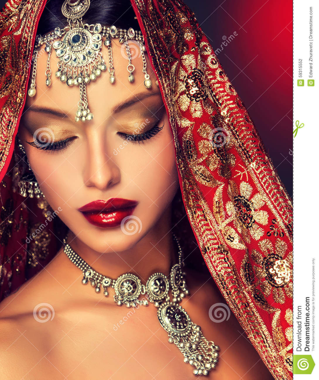 f01784872c Beautiful Indian woman portrait with jewelry. elegant Indian girl looking  to the side ,bollywood style.