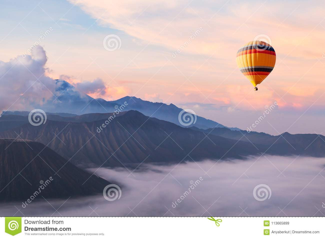 Beautiful inspirational landscape with hot air balloon flying in the sky, travel