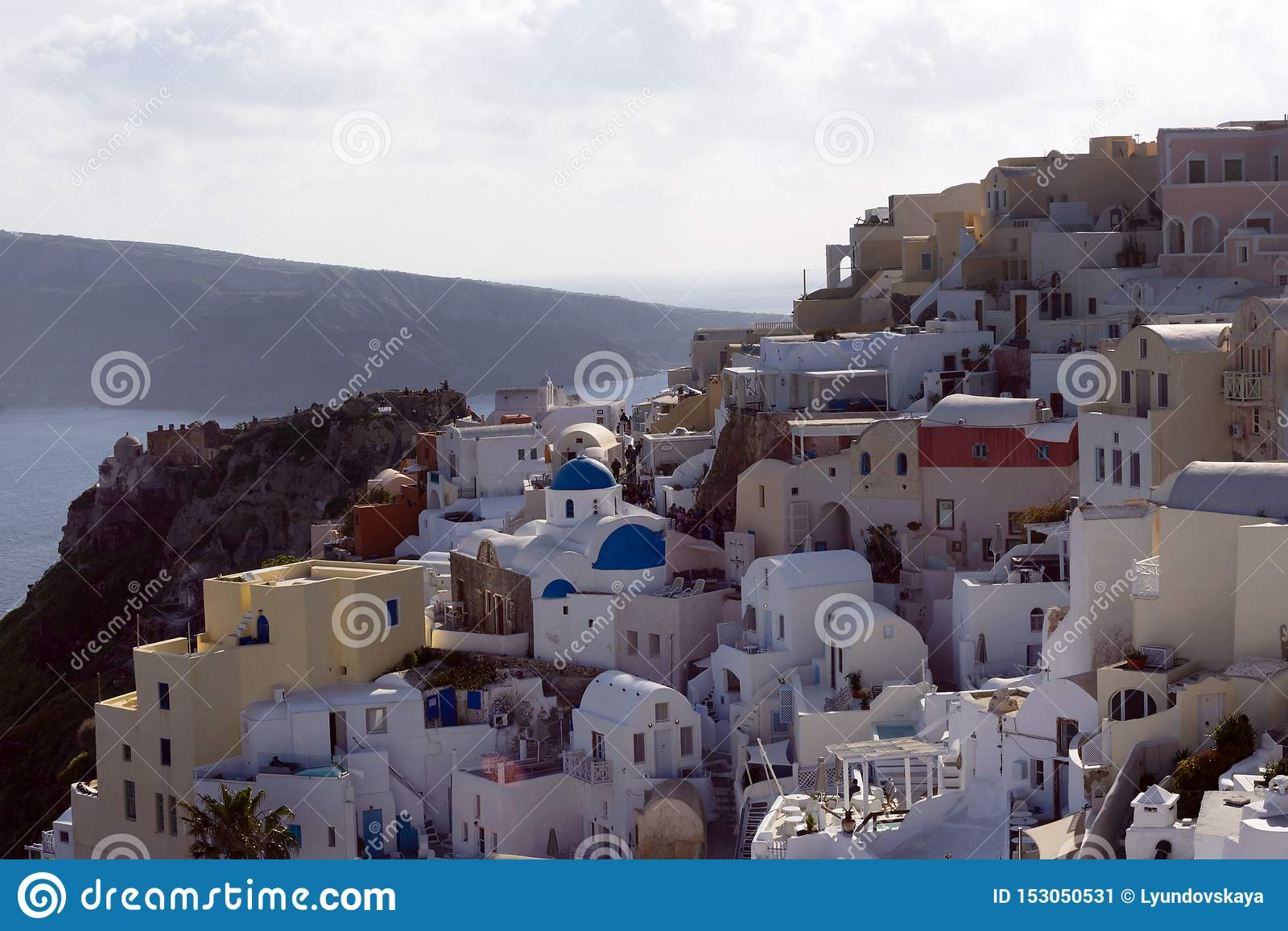 Beautiful island of Santorini, Greece. Traditional white greek houses against the backdrop of the sea. The city of Oia on the