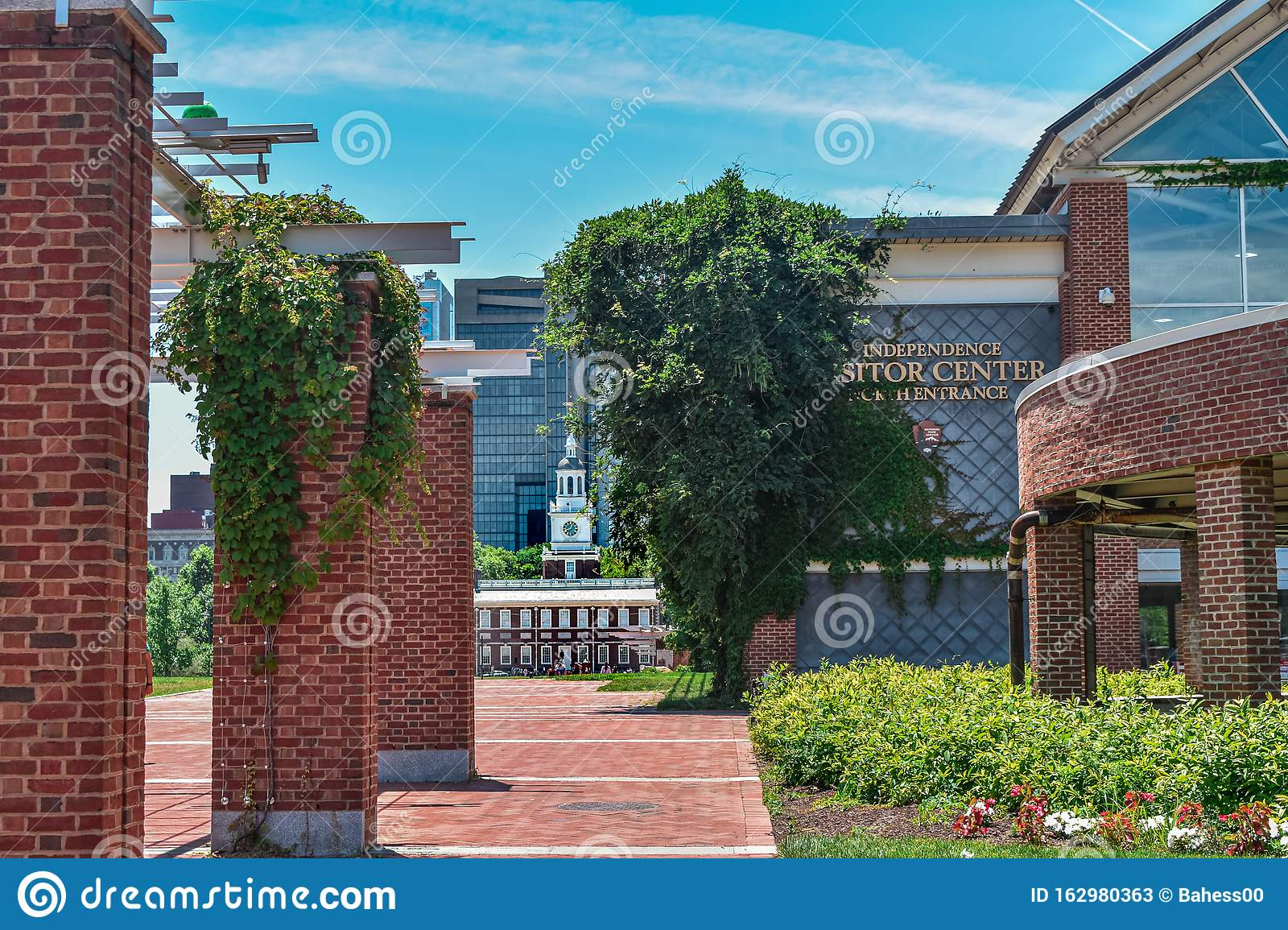 Ivy draped over bricks of Independence Visitor Center Philadelphia, Pennsylvania with Independence Hall in the background