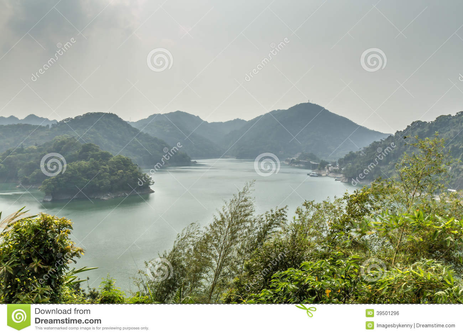 Beautiful jade green lake lake surrounded by mountains