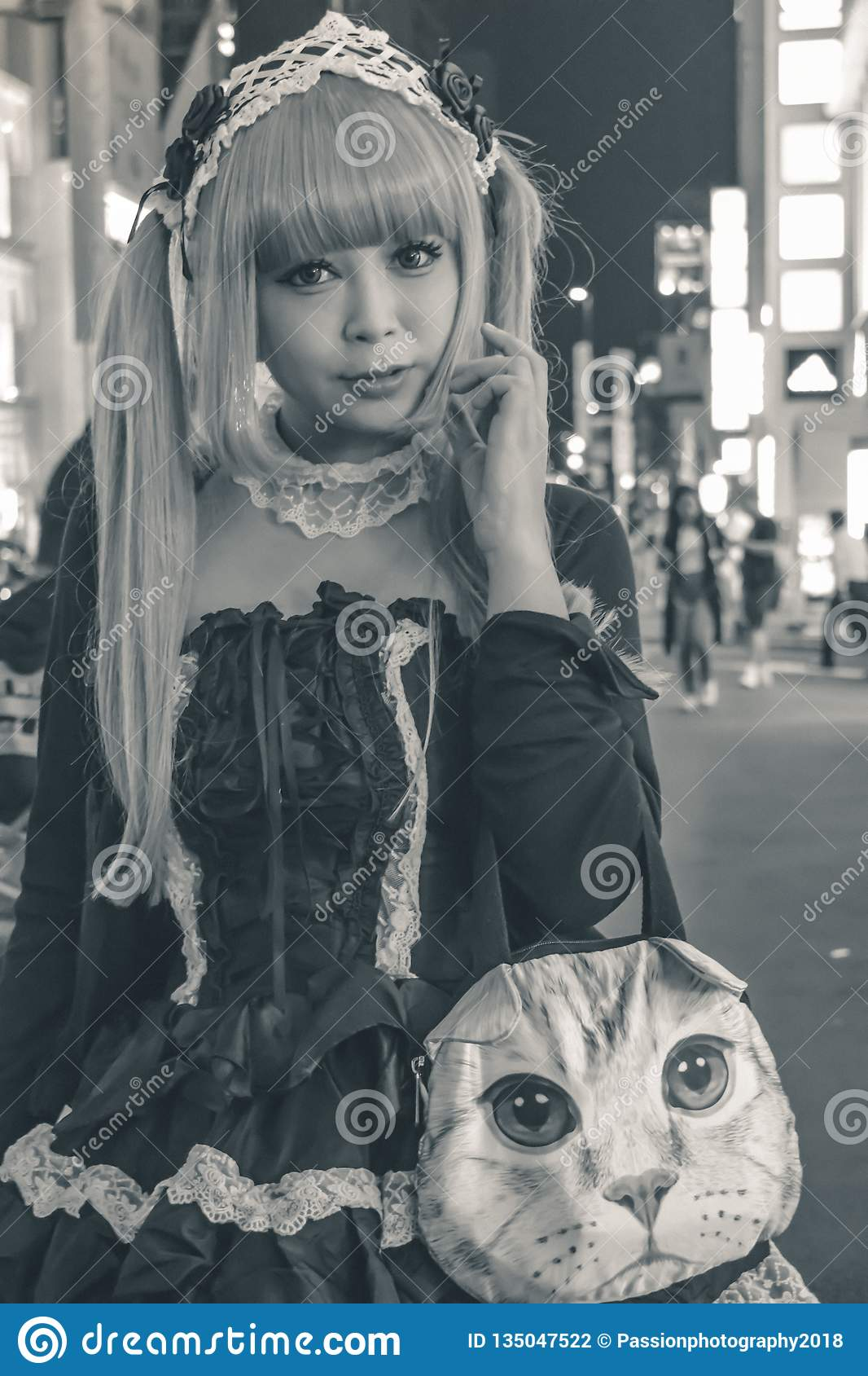 Beautiful Japanese girl in a maid costume in Tokyo