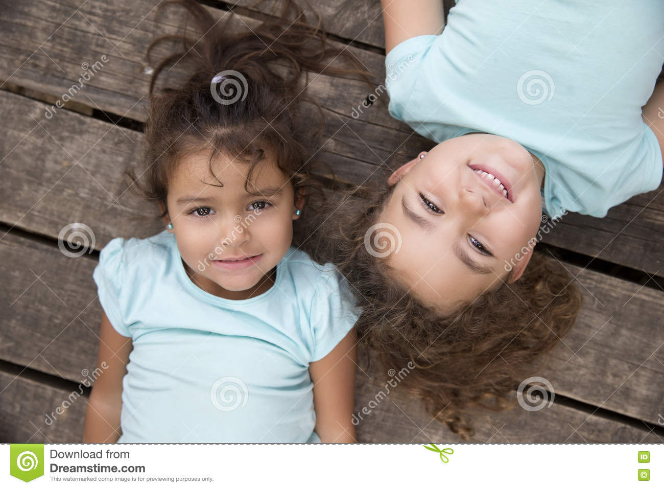 45ac75ee9 Beautiful Kids In Blue T-shirts On Wooden Ground Stock Image - Image ...