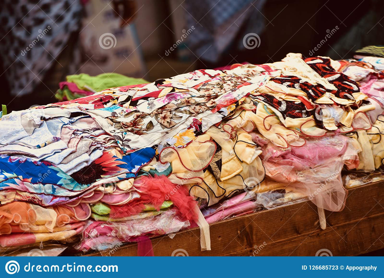 colourful dresses in display around a street shop unique photo