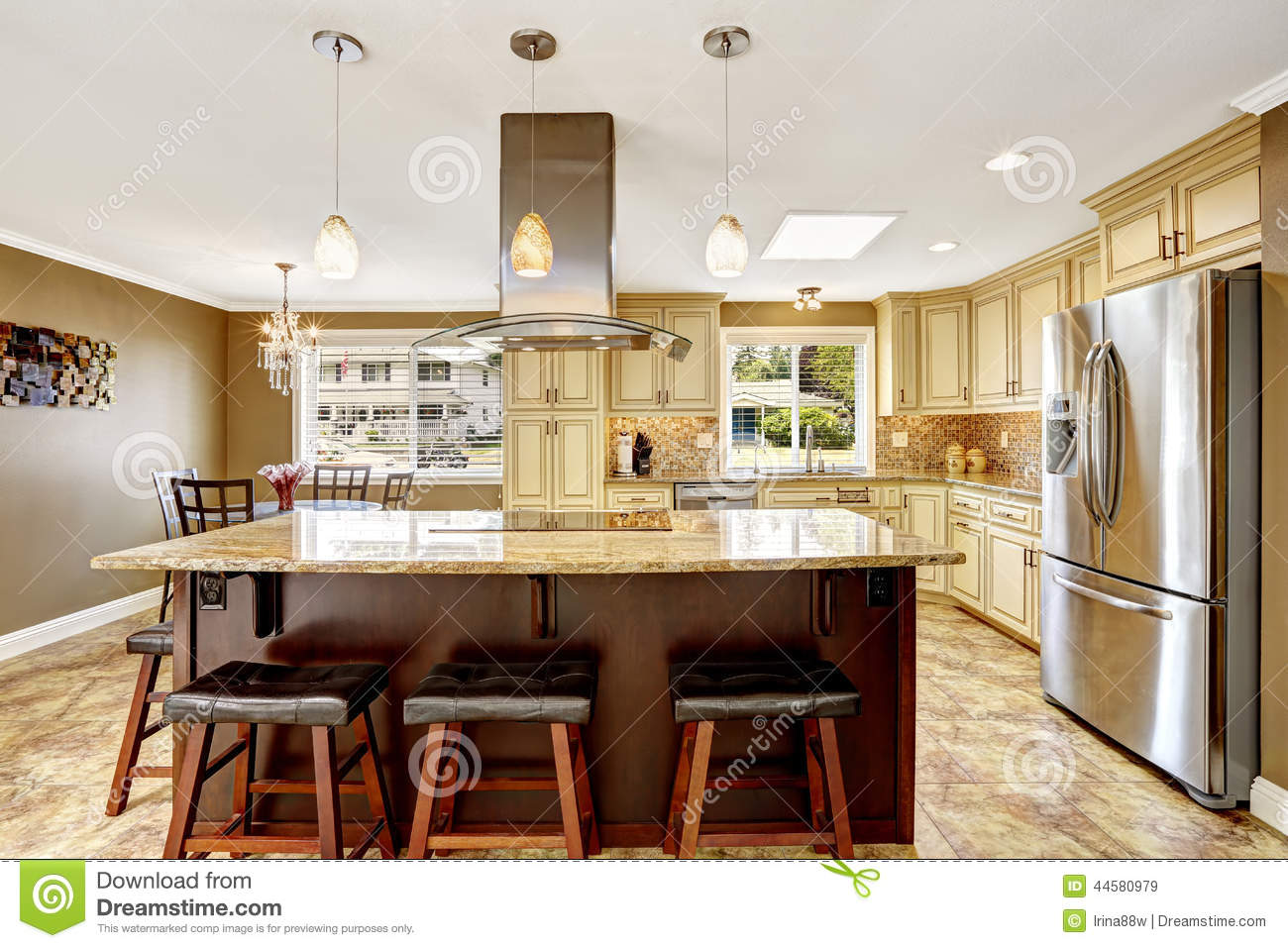 beautiful kitchen island with granite top and hood stock photo beautiful kitchen island with granite top and hood royalty free stock images